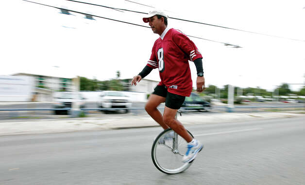 Darryl Padilla rides his unicycle north on Broadway Street on Sunday Oct. 7, 2012 during Siclovia. Photo: Edward A. Ornelas, San Antonio Express-News / © 2012 San Antonio Express-News