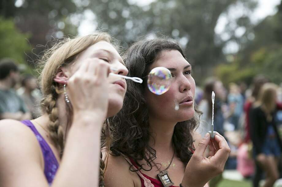 Naomi Reames (left) and Shawnee Gowan blow bubbles while attending the Soul Rebels show on the last day of Hardly Strictly Bluegrass in Golden Gate Park in San Francisco, Calf., on Sunday, October 7, 2012. Photo: Laura Morton, Special To The Chronicle