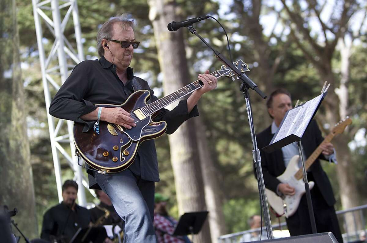 Boz Scaggs (left) and Jimmie Vaughan (right) perform with Doug Sahm's Phantom Playboys on the Star Stage during the last day of Hardly Strictly Bluegrass in Golden Gate Park in San Francisco, Calf., on Sunday, October 7, 2012.
