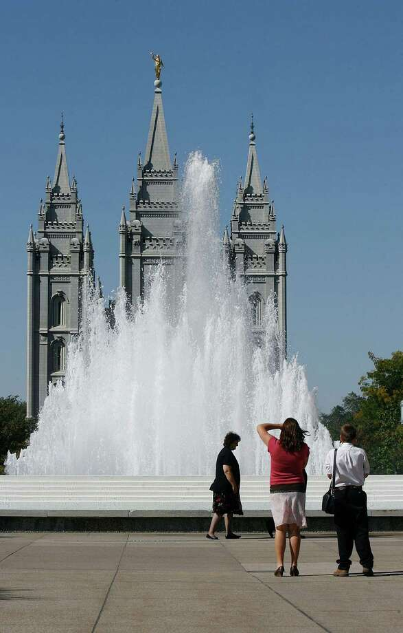 People take photos in Temple Square prior to the afternoon session of the 182nd Semiannual General Conference for The Church of Jesus Christ of Latter-day Saints in Salt Lake City on Saturday, Oct. 6, 2012. (AP Photo/The Salt Lake Tribune, Scott Sommerdorf) Photo: Scott Sommerdorf, Associated Press / The Salt Lake Tribune