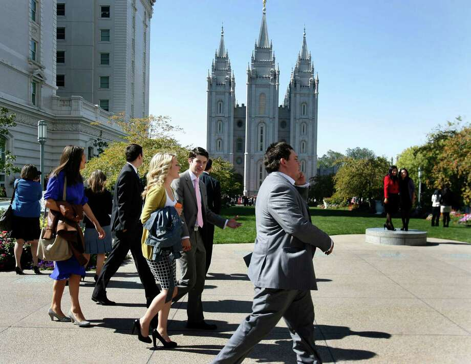 Young people walk by the LDS Temple during the 182nd Semiannual General Conference for The Church of Jesus Christ of Latter-day Saints in Salt Lake City on Saturday, Oct. 6, 2012. (AP Photo/The Salt Lake Tribune, Scott Sommerdorf) Photo: Scott Sommerdorf, Associated Press / The Salt Lake Tribune