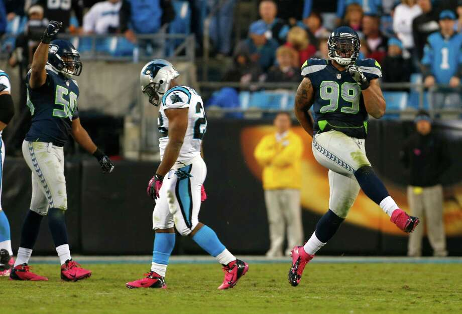 Seattle Seahawks' Alan Branch (99) reacts after recovering a Carolina Panthers fumble as Carolina Panthers' Jonathan Stewart (28) walks off during the fourth quarter of an NFL football game in Charlotte, N.C., Sunday, Oct. 7, 2012. The Seahawks won 16-12. Photo: AP