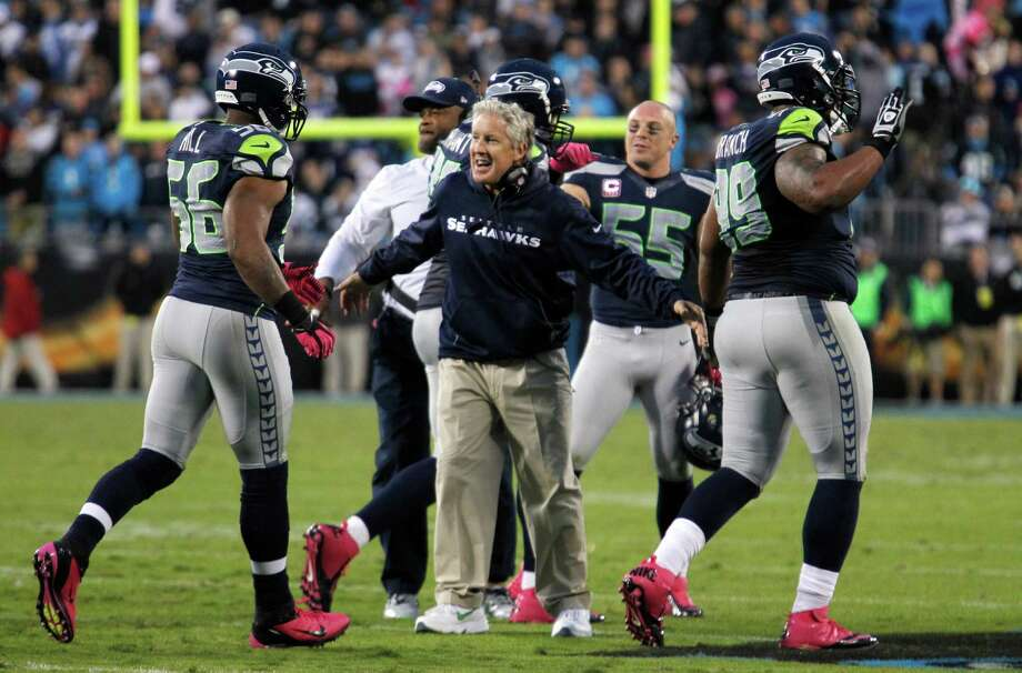 Seattle Seahawks head coach Pete Carroll, center reacts with his players after a defensive stop against the Carolina Panthers during the fourth quarter of an NFL football game in Charlotte, N.C., Sunday, Oct. 7, 2012. The Seahawks won 16-12. Photo: AP