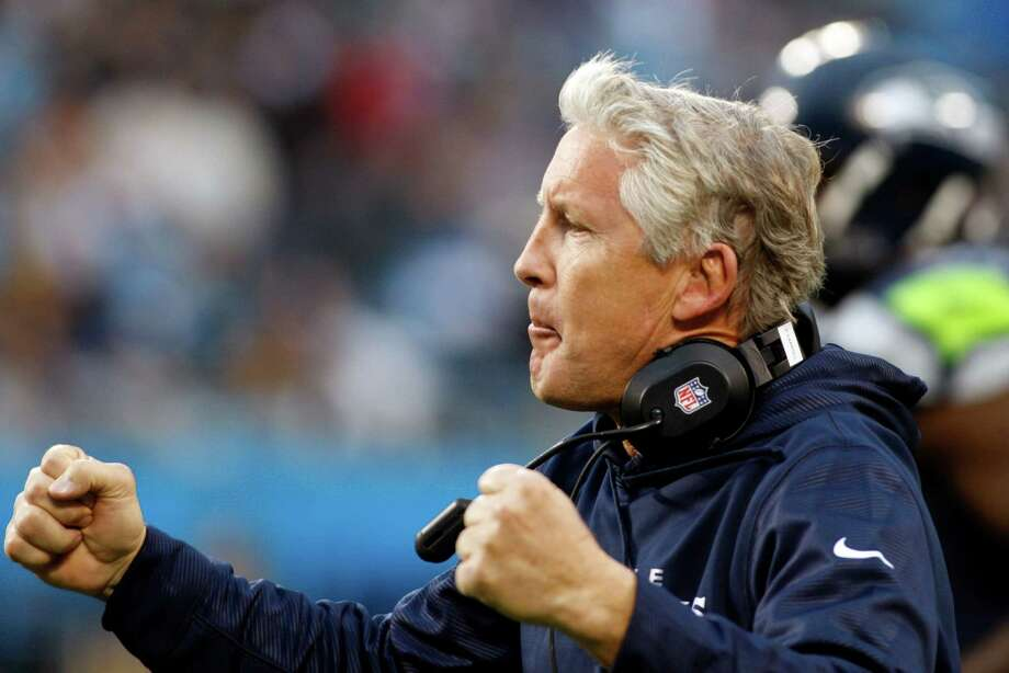Seattle Seahawks head coach Pete Carroll reacts after a Seahawks touchdown against the Carolina Panthers during the third quarter of an NFL football game in Charlotte, N.C., Sunday, Oct. 7, 2012. Photo: AP