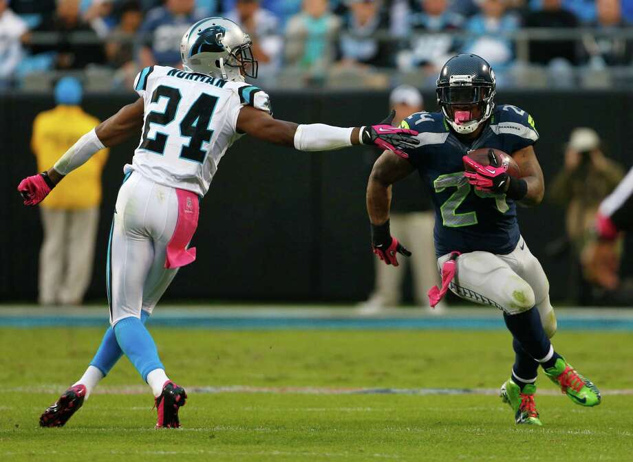 Seattle Seahawks' Marshawn Lynch, right, runs past Carolina Panthers' Josh Norman, left, during the third quarter of an NFL football game in Charlotte, N.C., Sunday, Oct. 7, 2012. Photo: AP