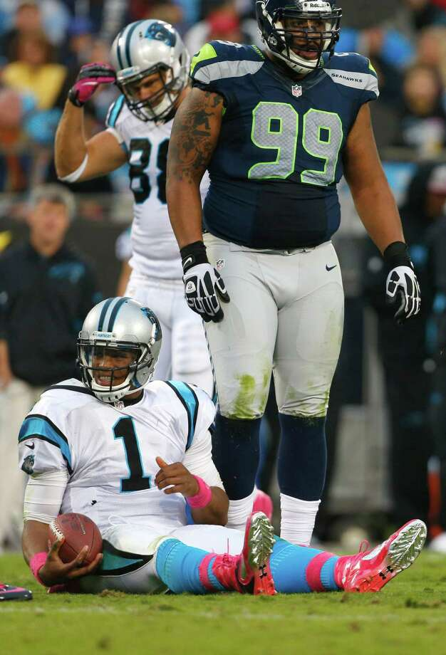 Carolina Panthers' Cam Newton (1) reacts after being sacked by Seattle Seahawks' Alan Branch (99) during the third quarter of an NFL football game in Charlotte, N.C., Sunday, Oct. 7, 2012. Photo: AP