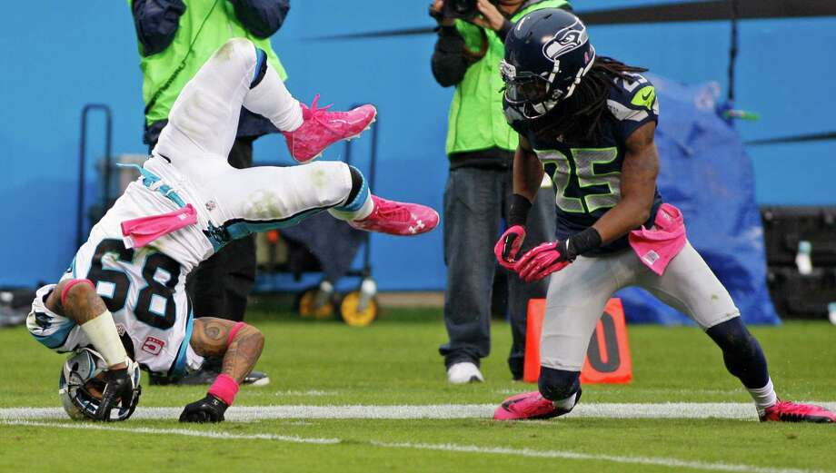 Carolina Panthers' Steve Smith (89) flips after missing a catch against Seattle Seahawks' Richard Sherman (25) during the third quarter of an NFL football game in Charlotte, N.C., Sunday, Oct. 7, 2012. Photo: AP