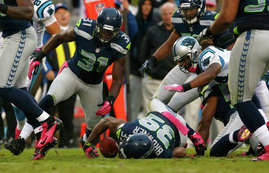 Seattle Seahawks' Brandon Browner (39) recovers a fumble by Carolina Panthers' DeAngelo Williams, right, during the third quarter of an NFL football game in Charlotte, N.C., Sunday, Oct. 7, 2012. Photo: AP