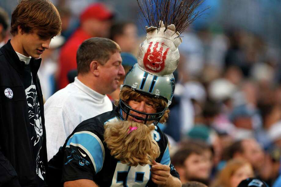 A Carolina Panthers fan looks on during the third quarter of an NFL football game against the Seattle Seahawks in Charlotte, N.C., Sunday, Oct. 7, 2012. Photo: AP