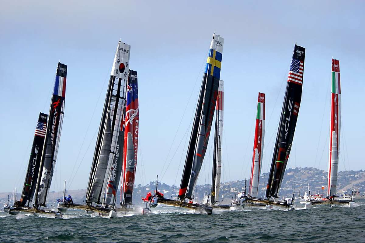 Boats take off at the start of the Super Sunday Fleet Race at the America's Cup World Series in San Francisco, Calif., Sunday, October 7, 2012.