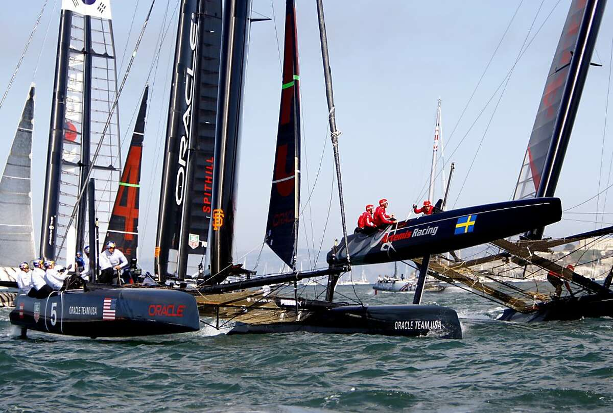 The Artemis Red team, right, and Oracle Team USA Coutts, left, round a turn with Oracle Team USA Spithill right behind them during the Super Sunday Fleet Race at the America's Cup World Series in San Francisco, Calif., Sunday, October 7, 2012.