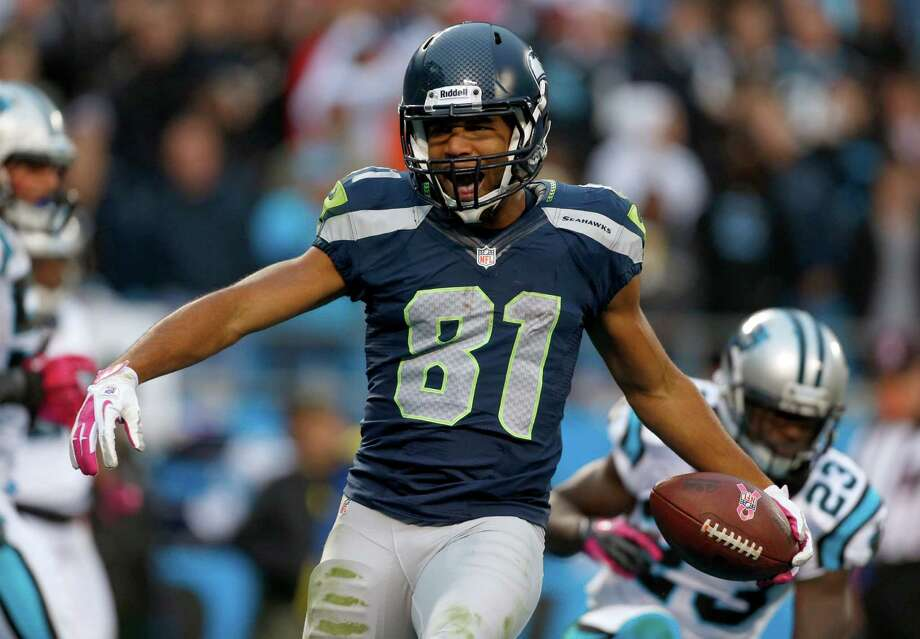 Seattle Seahawks' Golden Tate (81) reacts after his touchdown catch against the Carolina Panthers during the third quarter of an NFL football game in Charlotte, N.C., Sunday, Oct. 7, 2012. Photo: AP