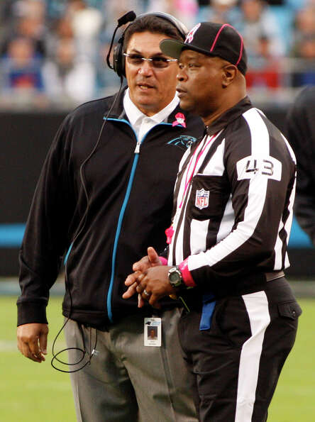 Carolina Panthers head coach Ron Rivera, left, talks with field judge Terry Brown (43) during the se