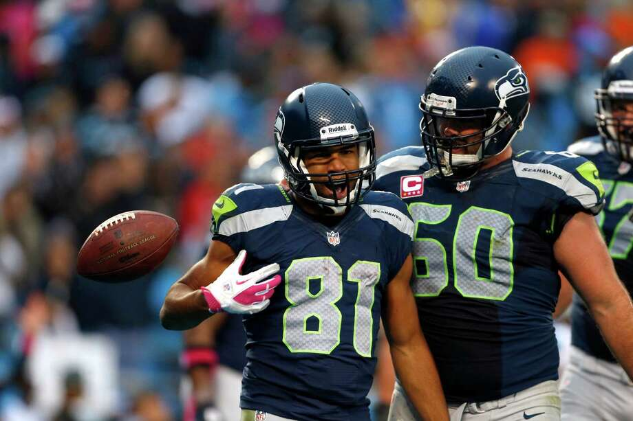 Seattle Seahawks' Golden Tate (81) celebrates his touchdown catch against the Carolina Panthers with teammate  K.J. Wright (50) during the third quarter of an NFL football game in Charlotte, N.C., Sunday, Oct. 7, 2012. Photo: AP