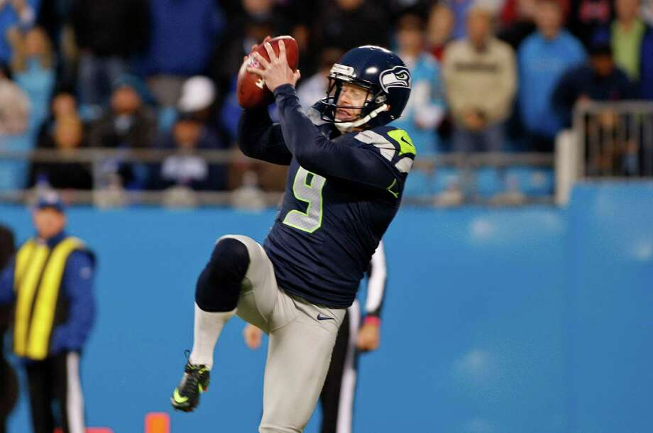Seattle Seahawks punter Jon Ryan (9) reaches for a high snap during the fourth quarter of an NFL football game in Charlotte, N.C., Sunday, Oct. 7, 2012. The Seahawks took a safety on the play. Photo: AP