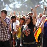 Fans cheers for Les Caypool's Duo De Twang on the Tower of Gold Stage.  Hardly Strictly Bluegrass festival in Golden Gate Park in San Francisco, CA Saturday October 6th, 2012.