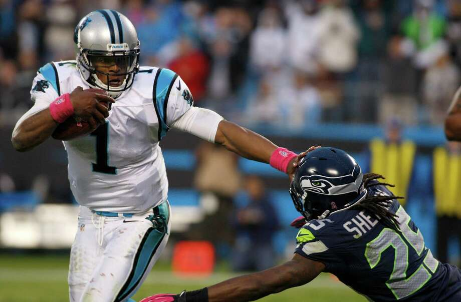 Carolina Panthers' Cam Newton (1) runs past Seattle Seahawks' Richard Sherman (25) during the fourth quarter of an NFL football game in Charlotte, N.C., Sunday, Oct. 7, 2012. The Seahawks won 16-12. Photo: AP