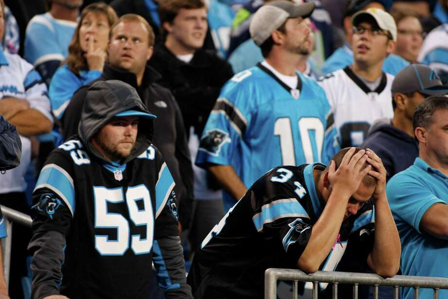 Carolina Panthers react during the fourth quarter of an NFL football game against the Seattle Seahawks in Charlotte, N.C., Sunday, Oct. 7, 2012. The Seahawks won 16-12. Photo: AP