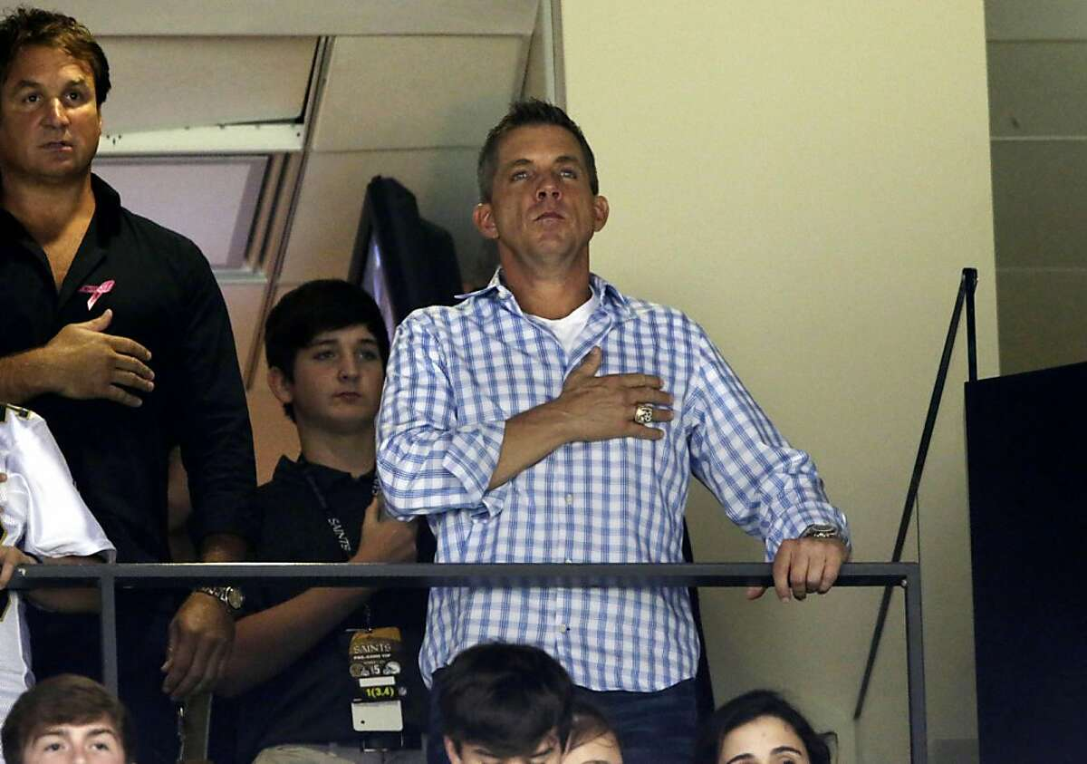 Suspended New Orleans Saints head coach Sean Payton holds his hand to his heart for the National Anthem before an NFL football game at the Mercedes-Benz Superdome in New Orleans, Sunday, Oct. 7, 2012. (AP Photo/Dave Martin)