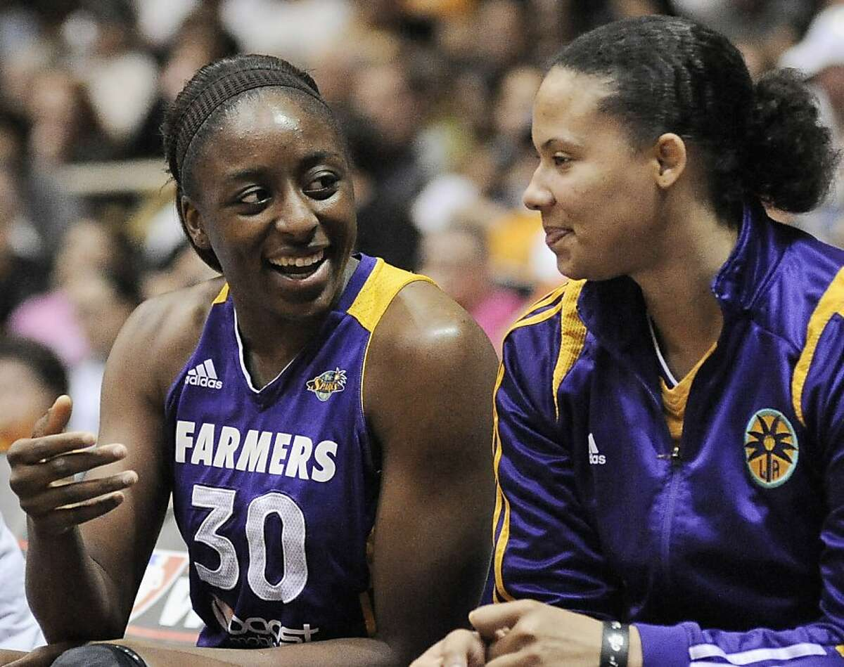 Los Angeles Sparks' Nneka Ogwumike (30) celebrates on the bench with teammate Kristi Toliver during the second half of a WNBA playoff basketball game against the San Antonio Silver Stars, Saturday, Sept. 29, 2012, in San Antonio. Los Angeles won 101-94. (AP Photo/Darren Abate)