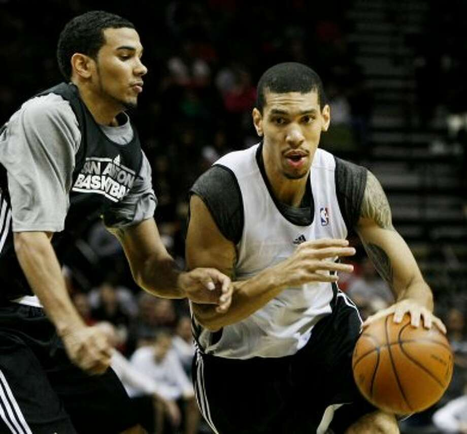 San Antonio Spurs' Danny Green, right, drives around Spurs' Cory Joseph, during an NBA basketball scrimmage, Monday, Dec. 19, 2011, in San Antonio. (Darren Abate/Special to the Express-News) (SPECIAL TO THE EXPRESS-NEWS)