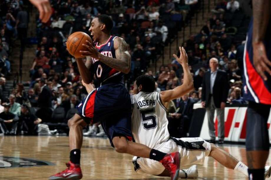 SPURS -- Atlanta Hawks guard Jeff Teague is fouled by San Antonio Spurs guard Cory Joseph after stealing the ball during the second half at the AT&T Center, Wednesday, Jan. 25, 2012. The Spurs won 105-83. Jerry Lara/San Antonio Express-News (San Antonio Express-News)
