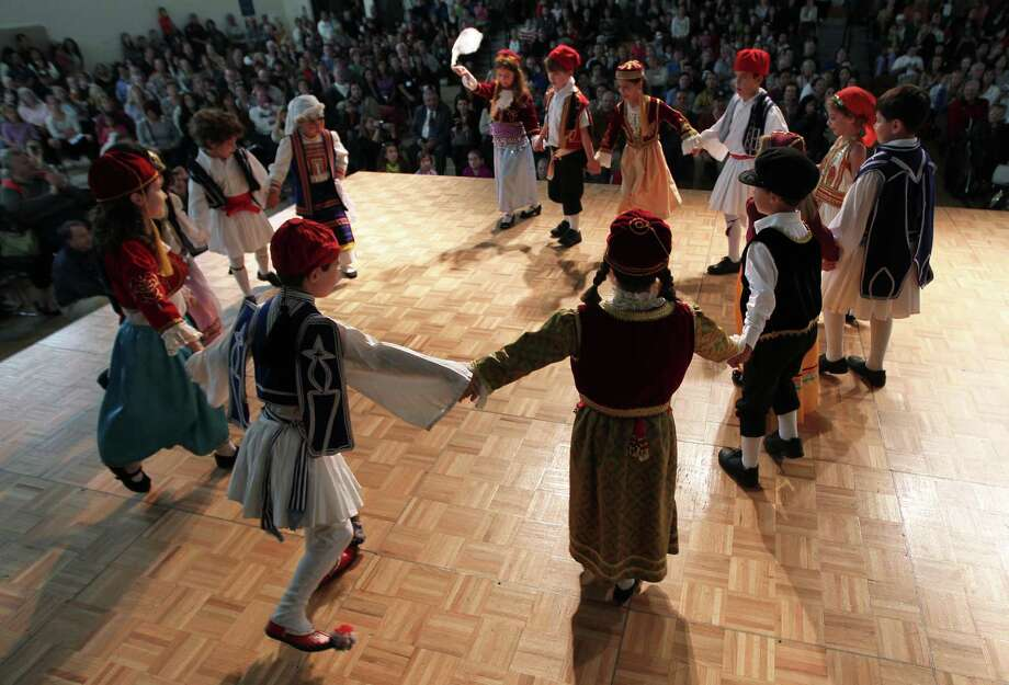 Children perform a dance during The Original Greek Festival at the Annunciation Orthodox Cathedral. Photo: James Nielsen / © Houston Chronicle 2012