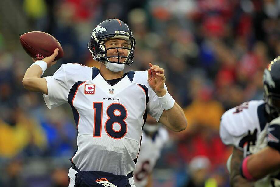 Denver Broncos quarterback Peyton Manning passes in the first quarter of an NFL football game against the New England Patriots Sunday, Oct. 7, 2012 in Foxborough, Mass. (AP Photo/Steven Senne) Photo: Steven Senne, Associated Press