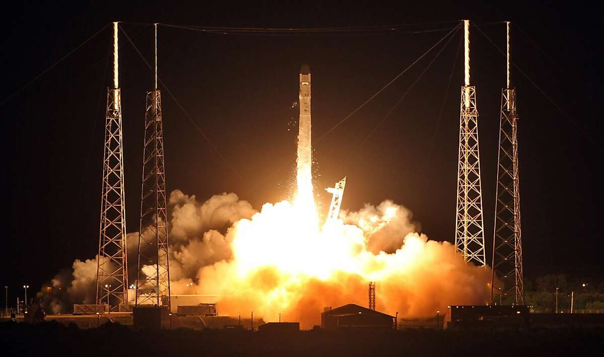 A Falcon9 rocket carrying a Dragon blasts off Sunday, October 7, 2012 for a scheduled launch at 8:35PM from Cape Canaveral Air Force Station in Florida. This is the first commercial re-supply mission to the International Space Station. (Red Huber/Orlando Sentinel/MCT)