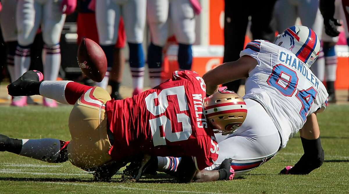 49ers linebacker Patrick Willis causes Bill's Scott Chandler to fumble in the 49ers victory against the Buffalo Bills at Candlestick Park in San Francisco, Calif., on Sunday, Oct. 7th, 2012.