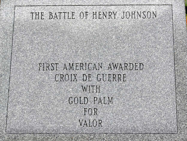 Close up of one of the script panels on The Battle of Henry Johnson statue in Washington Park Thursday, Oct. 4, 2012 in Albany, N.Y. World War I hero Sgt. Henry Johnson of Albany, subject of a 94-year effort by supporters to award him the Medal of Honor, will be featured in an hourlong episode of the PBS program ?History Detectives.? (Lori Van Buren / Times Union) Photo: Lori Van Buren