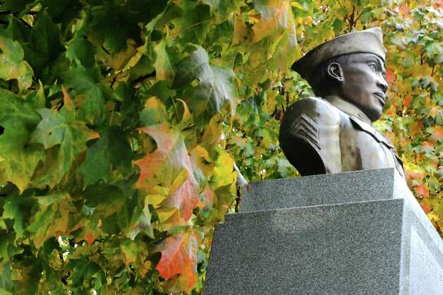 The Battle of Henry Johnson statue in Washington Park Thursday, Oct. 4, 2012 in Albany, N.Y. World War I hero Sgt. Henry Johnson of Albany, subject of a 94-year effort by supporters to award him the Medal of Honor, will be featured in an hourlong episode of the PBS program ?History Detectives.? (Lori Van Buren / Times Union) Photo: Lori Van Buren