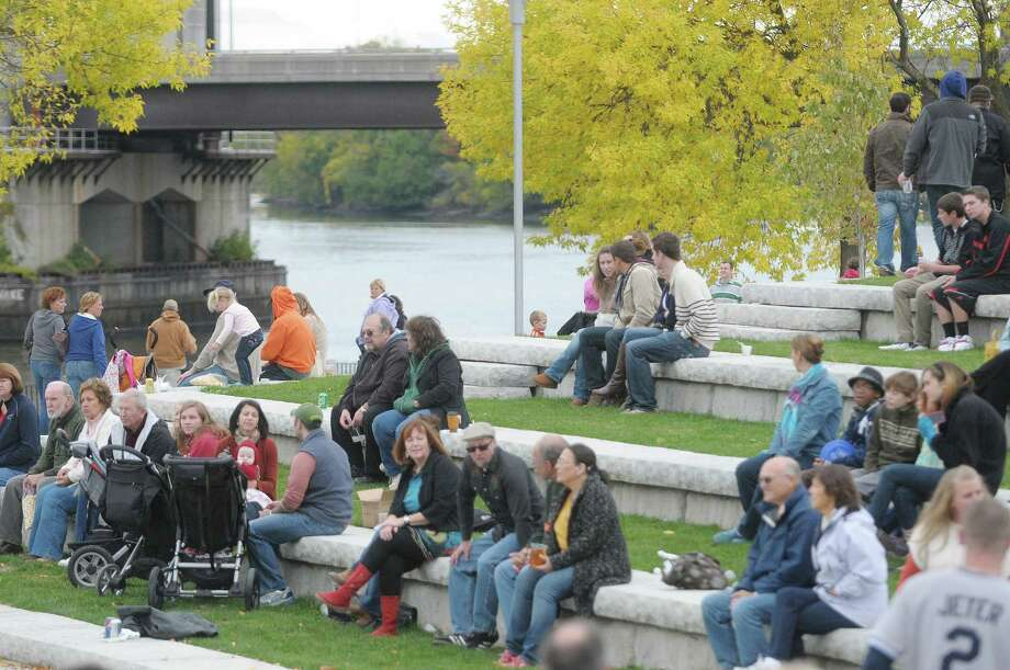 Visitors sit along the Hudson River at the 6th Annual Troy Chowderfest on Sunday, Oct. 7, 2012 in downtown Troy, NY.  This year around 20 Capital Region restaurants took part in the event creating their own unique chowder.   (Paul Buckowski / Times Union) Photo: Paul Buckowski