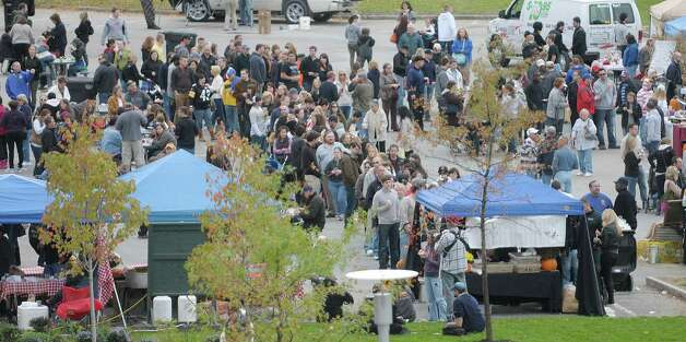 Visitors line up a taste of chowder at the 6th Annual Troy Chowderfest on Sunday, Oct. 7, 2012 in downtown Troy, NY.  This year around 20 Capital Region restaurants took part in the event creating their own unique chowder.   (Paul Buckowski / Times Union) Photo: Paul Buckowski