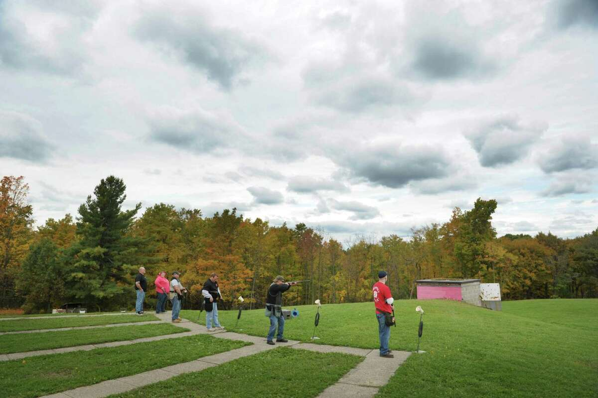 Participants take part in trap shooting at the Pleasantdale Rod & Gun Club during the Shoot for the Cure event on Sunday, Oct. 7, 2012 in Troy, NY. The first year event was organized by John Murray, a member of the club who runs the trap shooting league and who's grandmother passed away from breast cancer and his mother has battled cancer. The event raised over $7,000 and Murray said that all the money raised was going to the Cancer Treatment Center at Samaritan Hospital. Murray said that they were already planning to continue the event next year to make it bigger. Many area businesses including Antlers Inc. and Oakwood Trading Post donated items and money. Antlers Inc. donated a self-guided whitetail deer hunting trip in Kansas valued at $1,800, which was sold in a silent auction. Shooters taking part in the event paid $25 for a round of clay target shooting and non-shooters paid $10 with all food included in the admission price. (Paul Buckowski / Times Union)