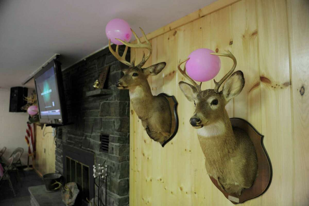 Pink balloons are seen on the antlers of mounted deer heads at the Pleasantdale Rod & Gun Club during the Shoot for the Cure event on Sunday, Oct. 7, 2012 in Troy, NY. The first year event was organized by John Murray, a member of the club who runs the trap shooting league and who's grandmother passed away from breast cancer and his mother has battled cancer. The event raised over $7,000 and Murray said that all the money raised was going to the Cancer Treatment Center at Samaritan Hospital. Murray said that they were already planning to continue the event next year to make it bigger. Many area businesses including Antlers Inc. and Oakwood Trading Post donated items and money. Antlers Inc. donated a self-guided whitetail deer hunting trip in Kansas valued at $1,800, which was sold in a silent auction. Shooters taking part in the event paid $25 for a round of clay target shooting and non-shooters paid $10 with all food included in the admission price. (Paul Buckowski / Times Union)
