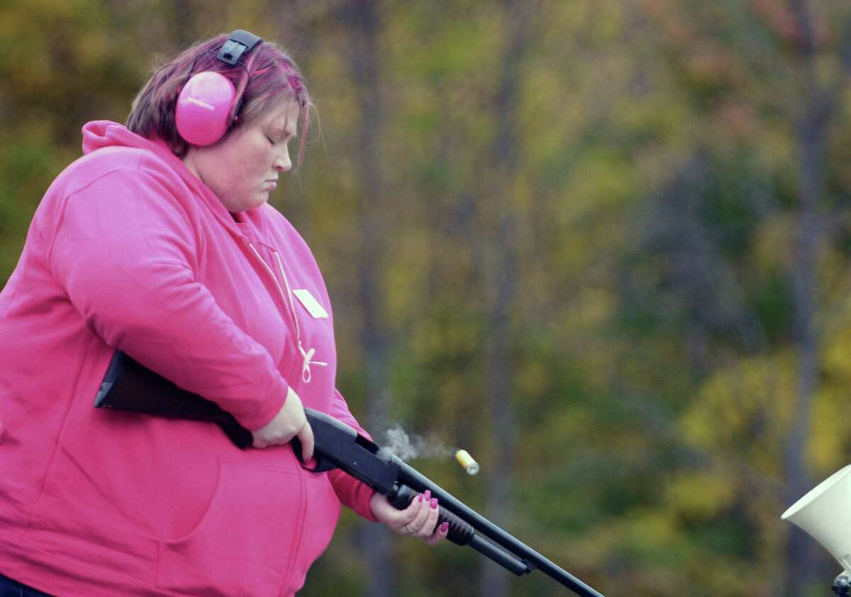 Courtney Painton from Troy ejects a shotgun shell after firing at a clay target during trap shooting at the Pleasantdale Rod & Gun Club during the Shoot for the Cure event on Sunday, Oct. 7, 2012 in Troy, NY. Painton's mother is a breast caner survivor. The first year event was organized by John Murray, a member of the club who runs the trap shooting league and who's grandmother passed away from breast cancer and his mother has battled cancer. The event raised over $7,000 and Murray said that all the money raised was going to the Cancer Treatment Center at Samaritan Hospital. Murray said that they were already planning to continue the event next year to make it bigger. Many area businesses including Antlers Inc. and Oakwood Trading Post donated items and money. Antlers Inc. donated a self-guided whitetail deer hunting trip in Kansas valued at $1,800, which was sold in a silent auction. Shooters taking part in the event paid $25 for a round of clay target shooting and non-shooters paid $10 with all food included in the admission price. (Paul Buckowski / Times Union)