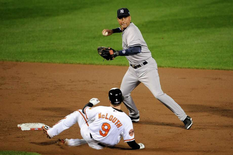 BALTIMORE, MD - OCTOBER 07:  Derek Jeter #2 of the New York Yankees forces out Nate McLouth #9 of the Baltimore Orioles as he turns a double play on a ball hit by J.J. Hardy #2 of the Orioles during Game One of the American League Division Series at Oriole Park at Camden Yards on October 7, 2012 in Baltimore, Maryland.  (Photo by Patrick McDermott/Getty Images) Photo: Patrick McDermott, Getty Images / 2012 Getty Images