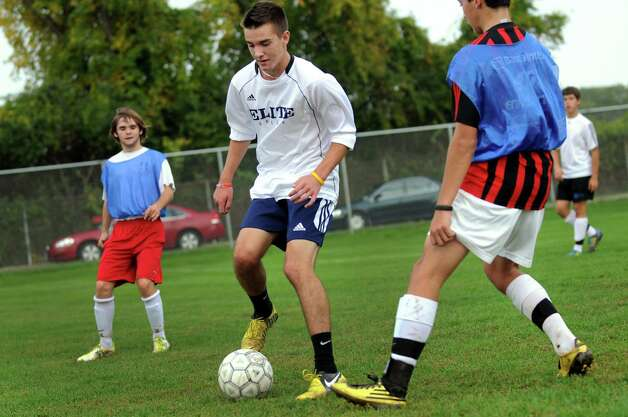 Scotia's Connor Flaherty, center, controls the ball during soccer practice on Friday, Oct. 5, 2012, at Scotia-Glenville High in Scotia, N.Y. (Cindy Schultz / Times Union) Photo: Cindy Schultz / 00019530A