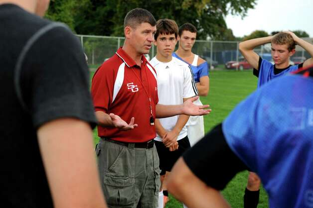 Scotia's coach Chris Bailey, center, instructs his team during soccer practice on Friday, Oct. 5, 2012, at Scotia-Glenville High in Scotia, N.Y. (Cindy Schultz / Times Union) Photo: Cindy Schultz / 00019530A