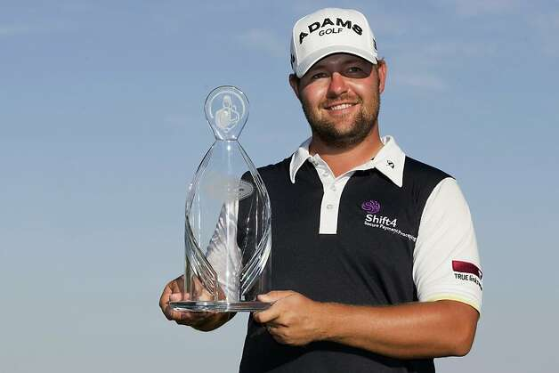 Ryan Moore picks up a trophy in Las Vegas - and $810,000. Photo: Julie Jacobson, Associated Press