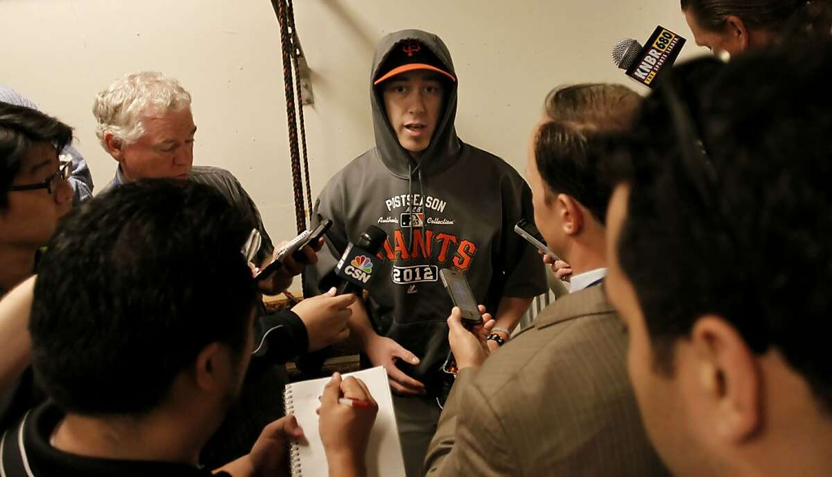 Giants pitcher Tim Lincecum meets with reporters before the game, as the San Francisco Giants prepare to take on the Cincinnati Reds in game two of the National League Divisional Series at AT&T Park San Francisco, Calif., on Sunday October 7, 2012.