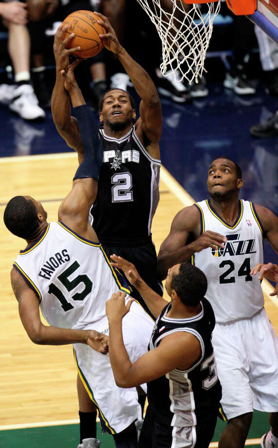 Spurs Kawhi Leonard grabs a rebound from Utah Jazz Derrick Favors during the second half of Game 4 in the Western Conference first round at EnergySolutions Arena in Salt Lake City, Monday, May 7, 2012. The Spurs won 87-81 and swept the series, 4-0. Photo: Jerry Lara, San Antonio Express-News / © San Antonio Express-News