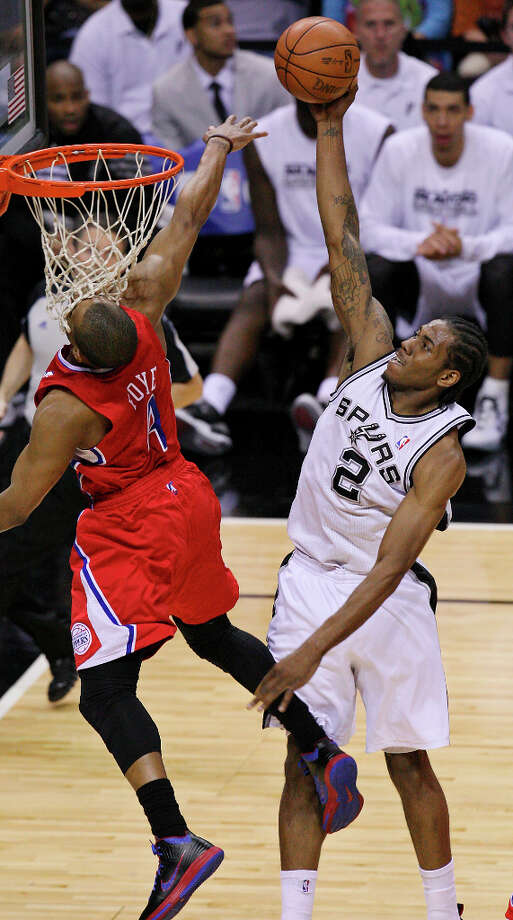 Spurs' Kawhi Leonard shoots overt Clippers' Randy Foye during first half action of Game 1 of the Western Conference semifinals Monday May 15, 2012 at the AT&T Center. Photo: EDWARD A. ORNELAS, SAN ANTONIO EXPRESS-NEWS / © SAN ANTONIO EXPRESS-NEWS (NFS)