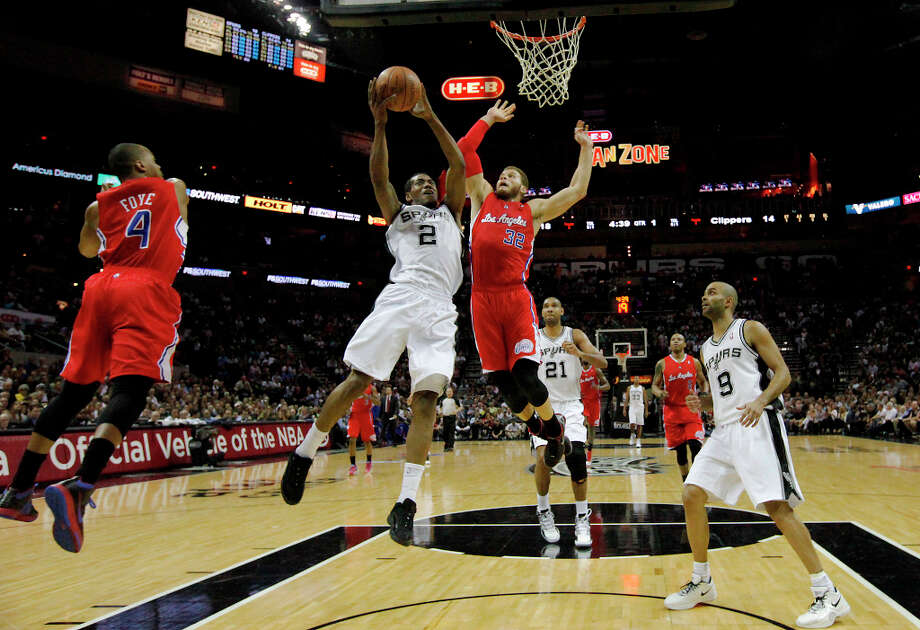 Spurs' Kawhi Leonard (2) goes up for a shot against Los Angeles Clippers' Blake Griffin (32) in the first half in Game 1 of the Western Conference semi-finals at the AT&T Center on Tuesday, May 15, 2012. Photo: Kin Man Hui, SAN ANTONIO EXPRESS-NEWS / San Antonio Express-News