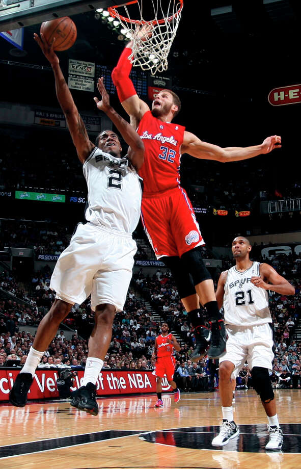 Spurs Kawhi Leonard attempts to score as Clippers Blake Griffin tries to defend during game one of the Western Conference semifinals at AT&T Center, Tuesday, May 15, 2012. The Spurs won 108-92, to lead the series, 1-0. Photo: Jerry Lara, San Antonio Express-News / © San Antonio Express-News