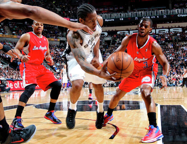 Spurs Kawhi Leonard scrambles for the ball as Clippers Randy Foye, left, and Chris Paul surround him during Game 1 of the Western Conference semifinals at AT&T Center, Tuesday, May 15, 2012. The Spurs won 108-92, to lead the series, 1-0. Photo: Jerry Lara, San Antonio Express-News / © San Antonio Express-News