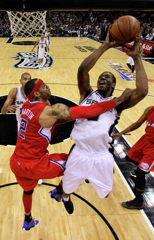 Spurs Kawhi Leonard drives to the basket as Los Angeles Clippers Kenyon Martin tries to defend during the second half of game one in the Western Conference semifinals at AT&T Center, Tuesday, May 15, 2012. The Spurs won 108-92, to lead the series, 1-0. Photo: Jerry Lara, San Antonio Express-News / © San Antonio Express-News