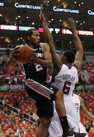 Spurs' Kawhi Leonard (2) drives around the Los Angeles Clippers' DeAndre Jordan (6) in the first half of game three of the Western Conference semifinals at the Staples Center in Los Angeles on Saturday, May 19, 2012. The Spurs won 96-86. Photo: Kin Man Hui, SAN ANTONIO EXPRESS-NEWS / San Antonio Express-News