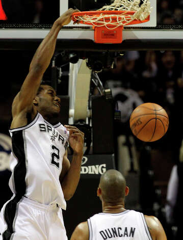 Spurs' Kawhi Leonard (2) slams the ball near San Antonio Spurs' Tim Duncan (21) during the first half of game two of the NBA Western Conference Finals in San Antonio, Texas on Tuesday, May 29, 2012. Photo: Kin Man Hui, San Antonio Express-News / © 2012 San Antonio Express-News